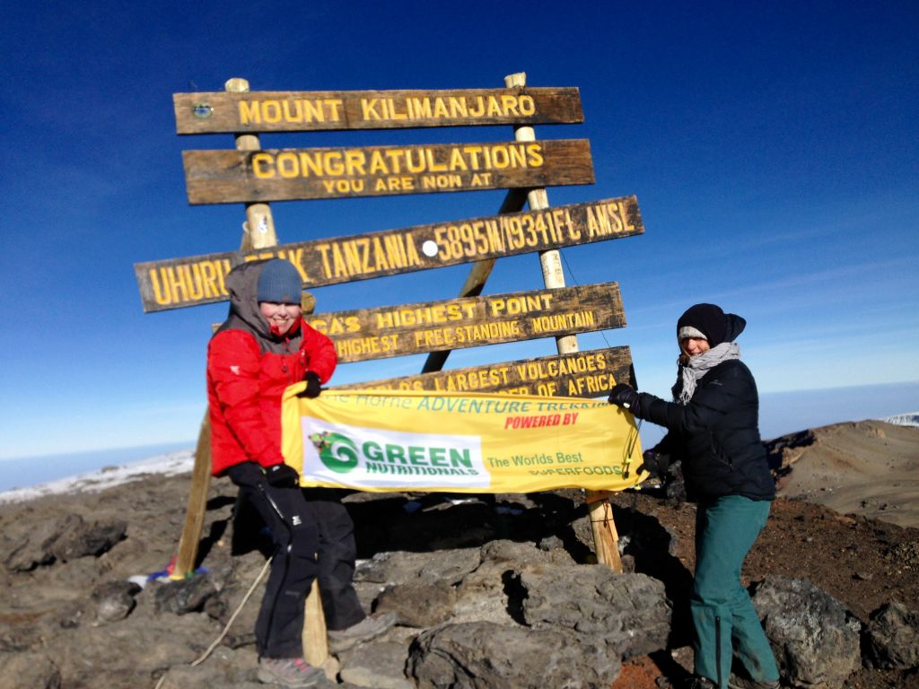 Kilimanjaro 2017. Cherie and client on the top of Kilimanjaro (5,895m)