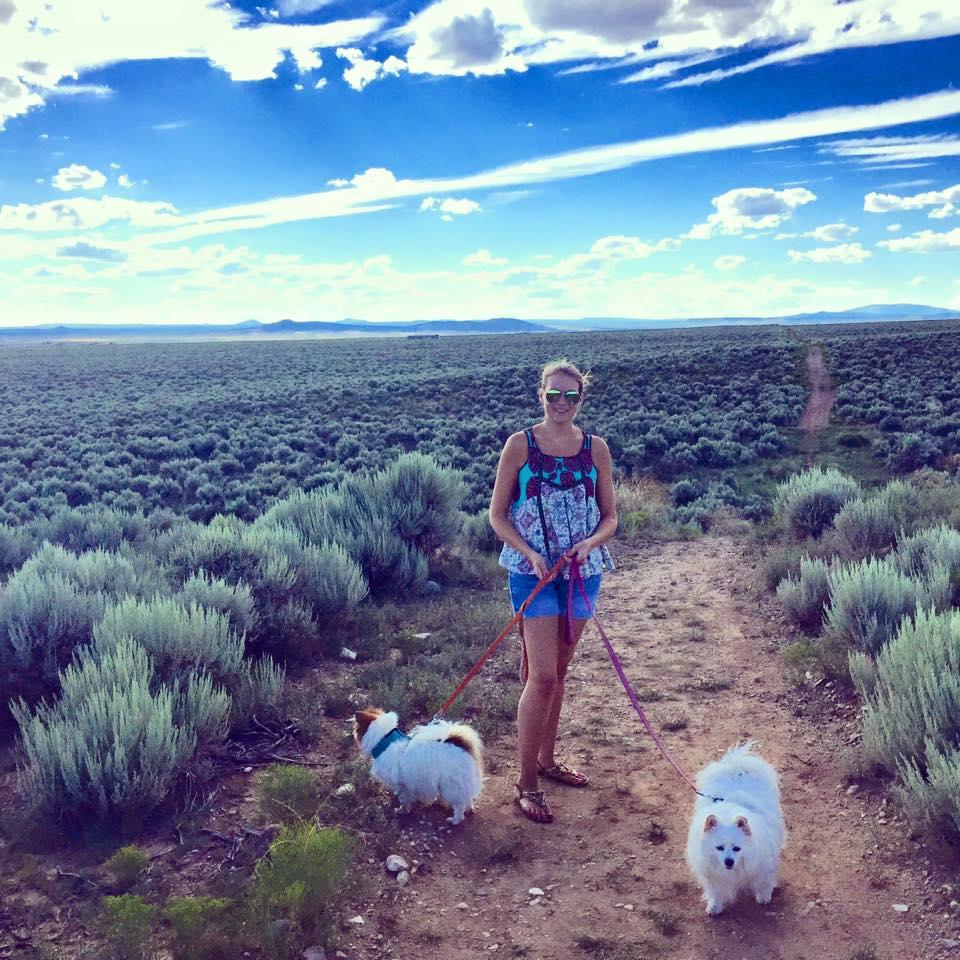 Margaux Rathbun walking dogs in nature